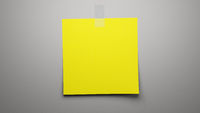 yellow paper on grey background