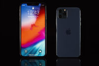 iPhone XS Max and iPhone 11 Pro on black