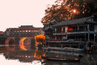 Arched bridge in Feng huang Old Town at dawn