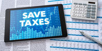 A tablet with financial documents - Save taxes