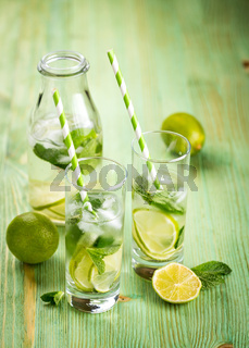 Lemonade drink on a wooden background