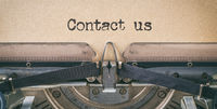 Text written with a vintage typewriter - Contact us