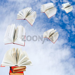books fly out of pile of books