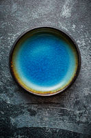 Handmade brown and blue glaze rustic pottery bowl