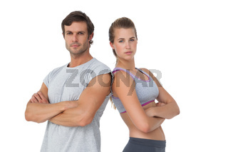 Portrait of a sporty couple with arms crossed