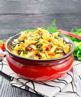Cabbage stew with chard in bowl on wooden board