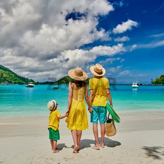 Family with three year old boy on beach. Seychelles, Mahe, Port Launay.
