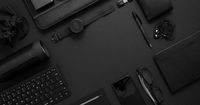 Business concept. Flat lay composition with various black gadgets on dark black surface