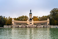 Monument to Alfonso XII and pond in Buen Reiro Park in Madrid during Fall