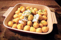 Closeup of baby potatoes about to go into the oven