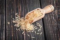 Long rice in wooden scoop