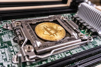 Bitcoin Cryptocurrency on computer circuit board