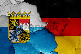 flags of Bavaria state and Germany painted on cracked wall