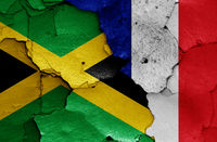 flags of Jamaica and France painted on cracked wall