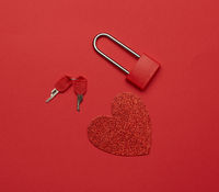 metal lock with keys and red paper heart