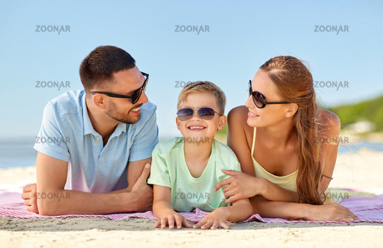 happy family lying on summer beach