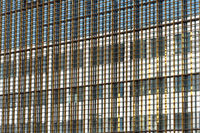 Glass facade with metal structure on a sunny day
