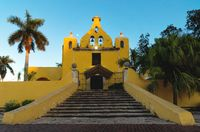 Colonial yellow church with bell tower 'Santa Isabel' in Merida , Yucatan, Mexico