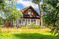 Old rural wooden house in abandoned russian village