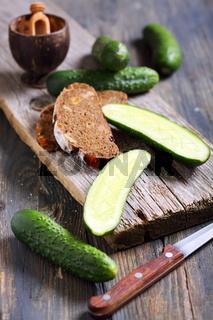 Black bread and fresh cucumbers.