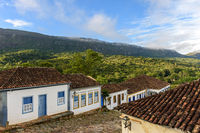 Stone streets and old houses in colonial architecture with mountains