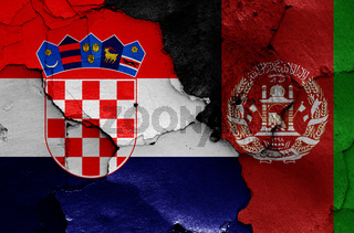 flags of Croatia and Afghanistan painted on cracked wall
