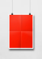 Red folded poster hanging on a white wall with clips