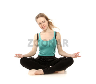 Young woman in advanced sitting yoga pose, isolated on white background