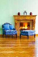 Blue armchair fireplace