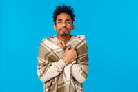 Wais-up portrait sick african american hipster guy with modern afro haircut, sneezing, have runny nose, wrap body in blanket get warm, caught cold during winter holidays, stay home blue background