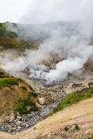 Exciting volcanic landscape, eruption fumarole, hot spring, gas-steam activity in crater volcano