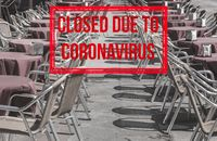 Empty tables and chairs of local restaurant in Salamanca closed due to virus of Covid-19