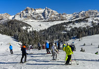 Skiers on a ski slope in the ski resort Alta BadiaDolomites, South Tyrol, Italy