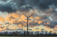 single windmill with colourful clouds