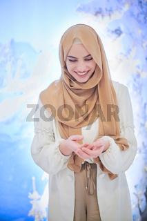 beautiful muslim woman making traditional prayer to God