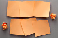 Orange Blank Paper Notes And Crumbled Paper