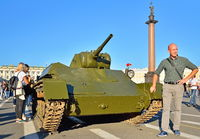 Tourists are photographed with a Light tank T-70 times world war