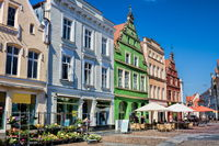 güstrow, germany - 07.06.2019 - renovated row of houses on the market square