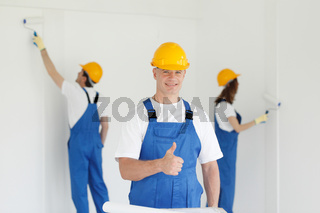 Worker gives thumb up