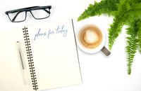 open spiral notebook with handwritten text PLANS FOR TODAY