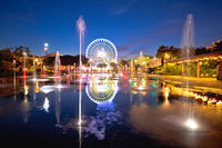City of Nice ferris wheel and fountain evening mirror view