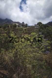 View up to steep overgrown mountain with the village of Santa Cruz la Laguna, Guatemala