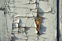 cracked color on a wall outside