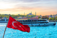 Turkish flag, the ship in the Bosporus and Hagia Sophia in the background, Istanbul, Turkey