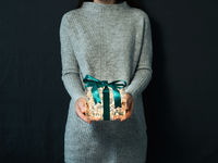 Christmas,New Year concept,luminous gift box,hands