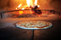 rustic pizza in wood fired oven
