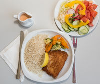 Cordon bleu with salad - pork cutlet stuffed with cheese and ham