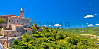 Idyllic istrian stone village of Plomin on green hill panoramic view