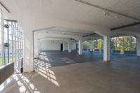 Large empty hall in the Bauhaus Dessau with big windows