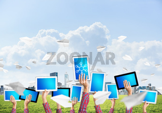 Close of woman hands in line showing tablet pc with blank blue screen
